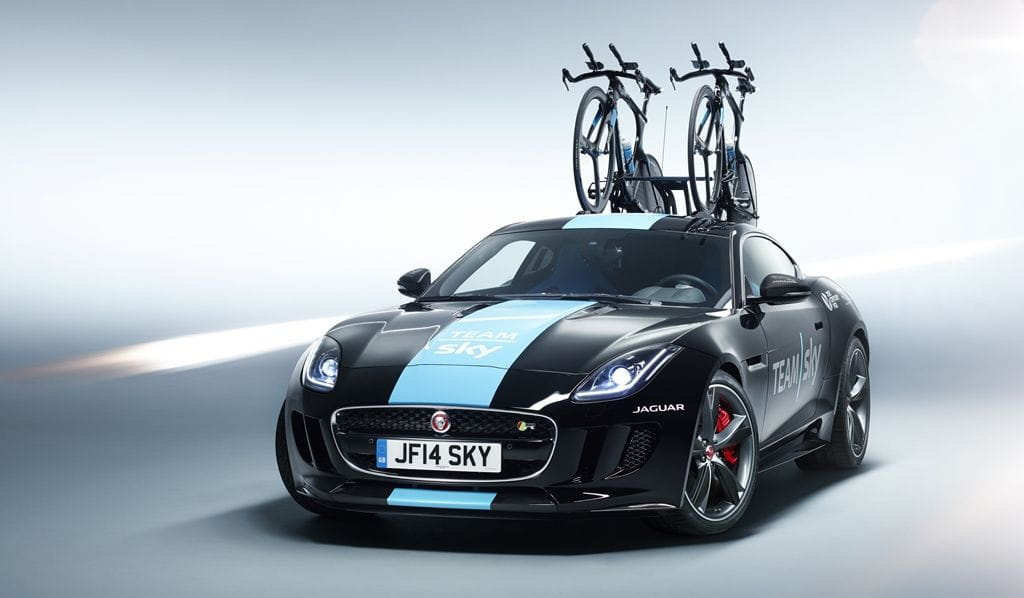 What are a Jaguar F-Type R Coupé and its 550 hp doing in the Tour de France?